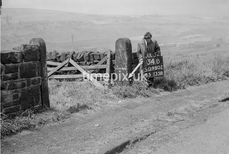 SD980234B, Man marking Ordnance Survey minor control revision point with an arrow in 1950s