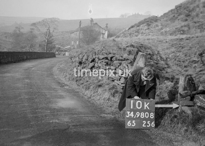 SD980810K, Man marking Ordnance Survey minor control revision point with an arrow in 1950s