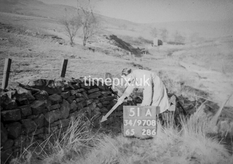 SD970851B, Man marking Ordnance Survey minor control revision point with an arrow in 1950s