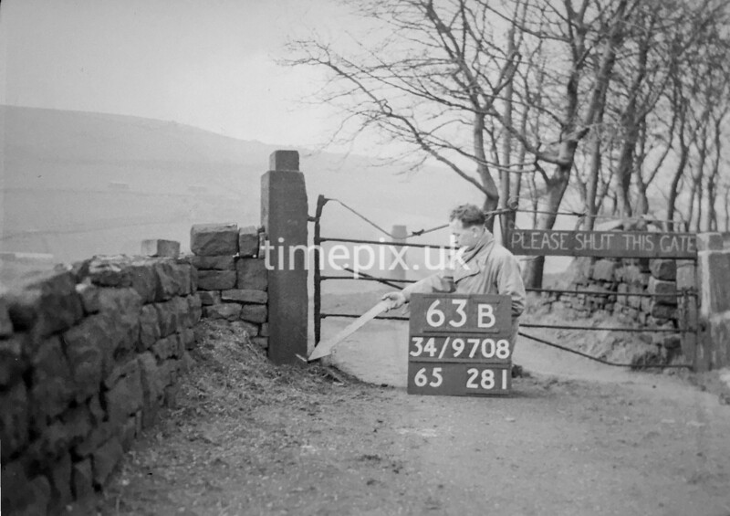 SD970863B, Man marking Ordnance Survey minor control revision point with an arrow in 1950s