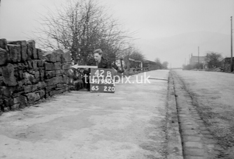 SD980342B, Man marking Ordnance Survey minor control revision point with an arrow in 1950s