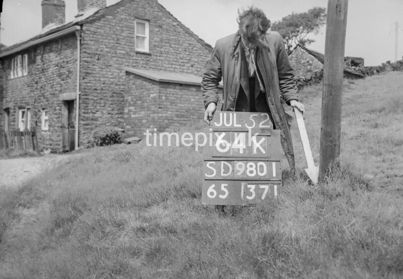 SD980164K, Man marking Ordnance Survey minor control revision point with an arrow in 1950s
