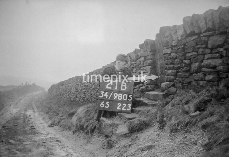 SD980521B, Man marking Ordnance Survey minor control revision point with an arrow in 1950s