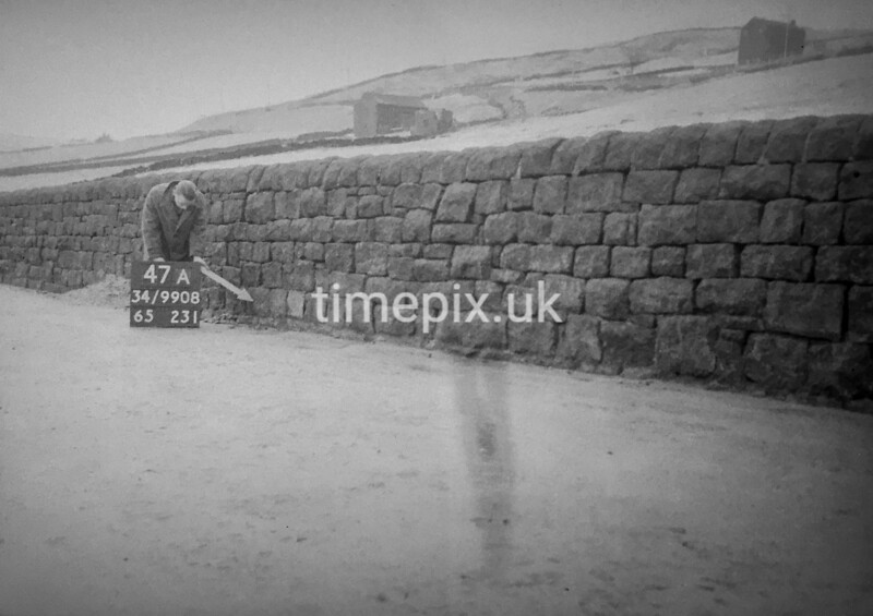SD990847A, Man marking Ordnance Survey minor control revision point with an arrow in 1950s