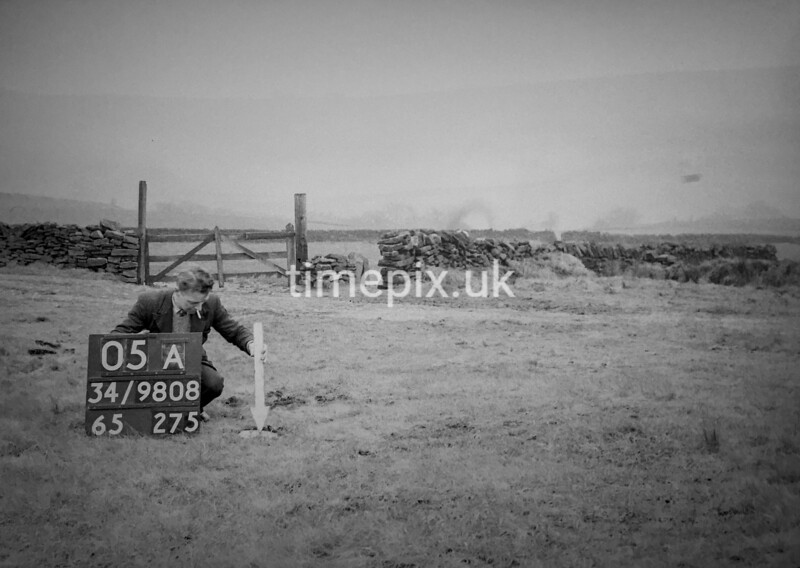 SD980805A, Man marking Ordnance Survey minor control revision point with an arrow in 1950s
