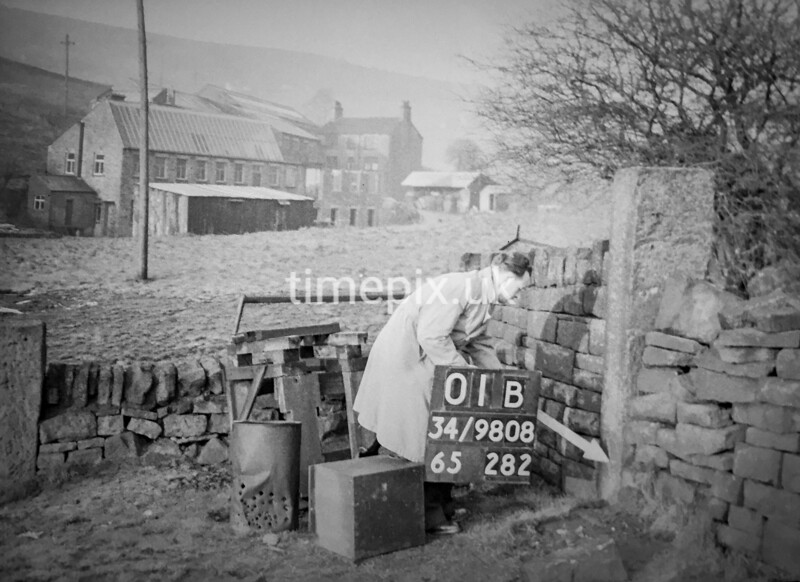 SD980801B, Man marking Ordnance Survey minor control revision point with an arrow in 1950s