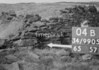 SD990504B, Man marking Ordnance Survey minor control revision point with an arrow in 1950s