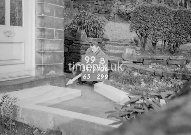 SD970699B, Man marking Ordnance Survey minor control revision point with an arrow in 1950s