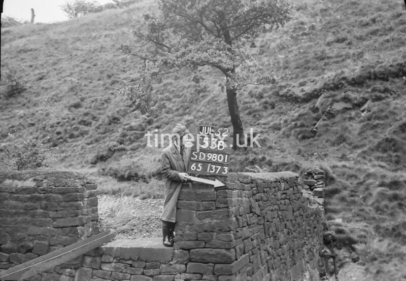 SD980153B, Man marking Ordnance Survey minor control revision point with an arrow in 1950s