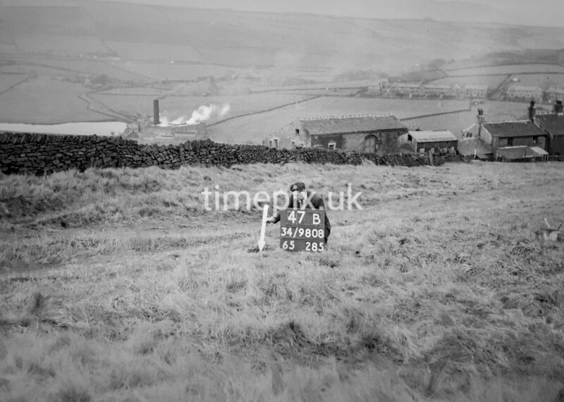 SD980847B, Man marking Ordnance Survey minor control revision point with an arrow in 1950s