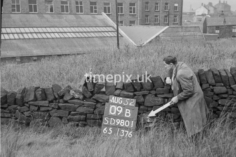 SD980109B, Man marking Ordnance Survey minor control revision point with an arrow in 1950s