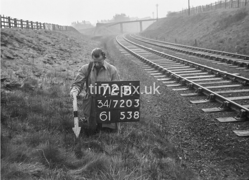 SD720372B, Man marking Ordnance Survey minor control revision point with an arrow in 1950s