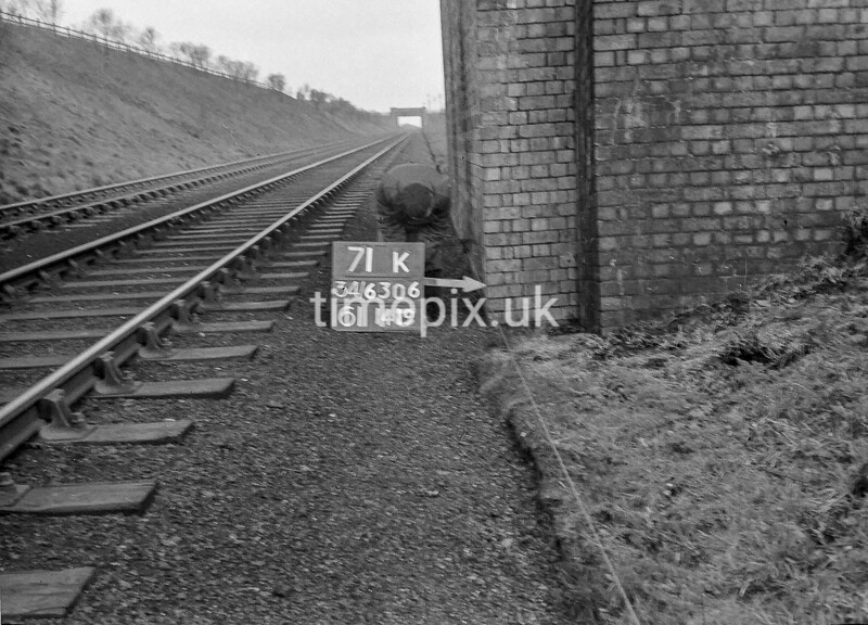 SD630671K, Man marking Ordnance Survey minor control revision point with an arrow in 1950s