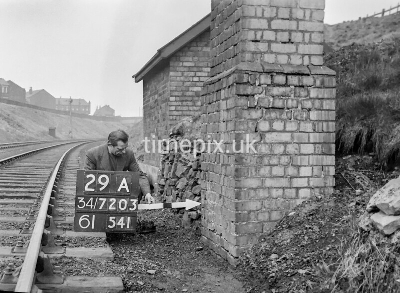 SD720329A, Man marking Ordnance Survey minor control revision point with an arrow in 1950s