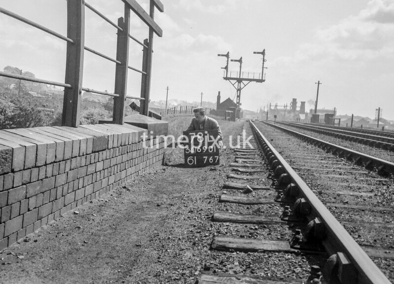 SD690178L, Man marking Ordnance Survey minor control revision point with an arrow in 1950s