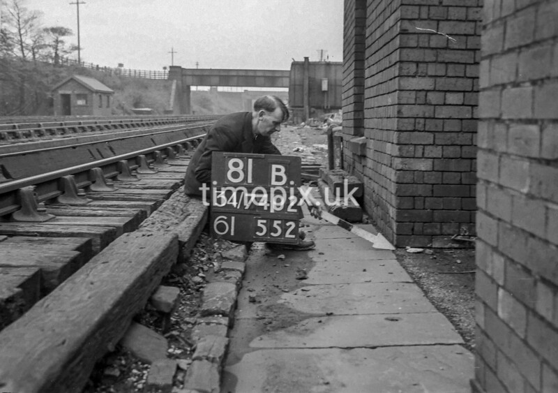 SD740281B, Man marking Ordnance Survey minor control revision point with an arrow in 1940s