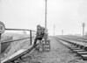 SD590654A, Man marking Ordnance Survey minor control revision point with an arrow in 1950s