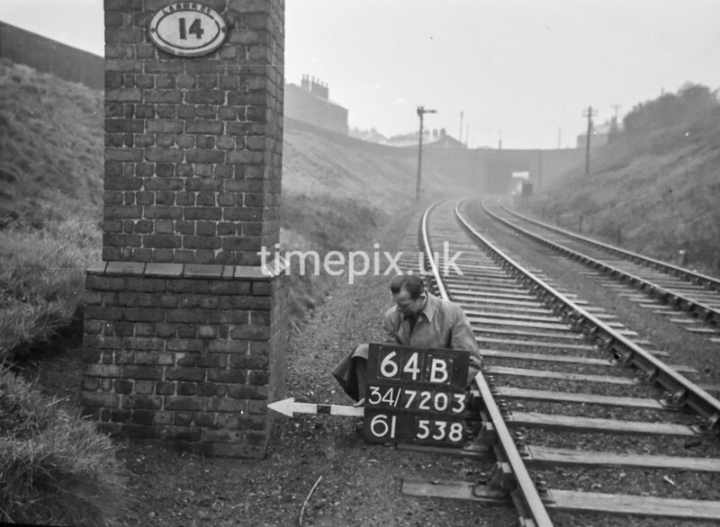 SD720364B, Man marking Ordnance Survey minor control revision point with an arrow in 1950s