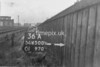 SD650036A, Man marking Ordnance Survey minor control revision point with an arrow in 1940s