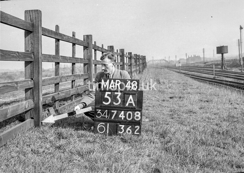SD740853A, Man marking Ordnance Survey minor control revision point with an arrow in 1940s