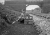 SD740813A, Man marking Ordnance Survey minor control revision point with an arrow in 1940s