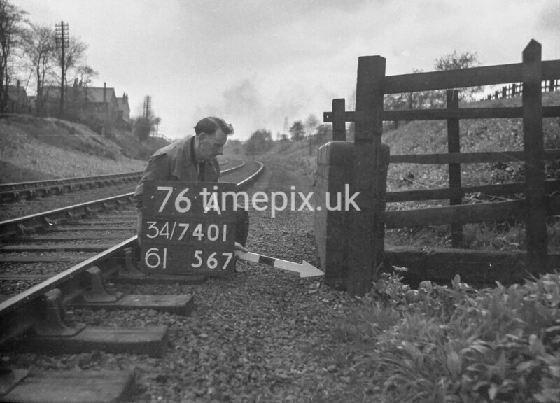 SD740176A, Man marking Ordnance Survey minor control revision point with an arrow in 1940s