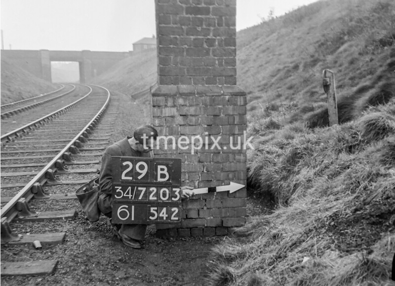 SD720329B, Man marking Ordnance Survey minor control revision point with an arrow in 1950s