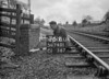 SD740176B, Man marking Ordnance Survey minor control revision point with an arrow in 1940s