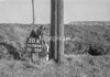 SD740420A, Man marking Ordnance Survey minor control revision point with an arrow in 1940s