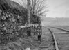 SD590639A, Man marking Ordnance Survey minor control revision point with an arrow in 1950s