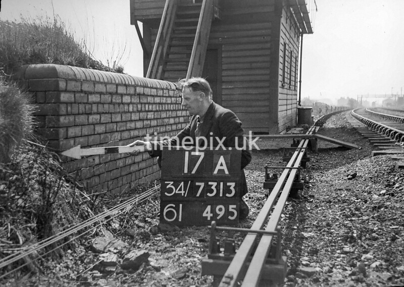 SD731317A, Man marking Ordnance Survey minor control revision point with an arrow in 1940s