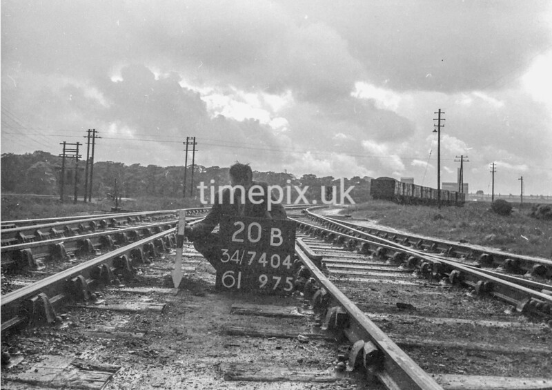 SD740420B, Man marking Ordnance Survey minor control revision point with an arrow in 1940s