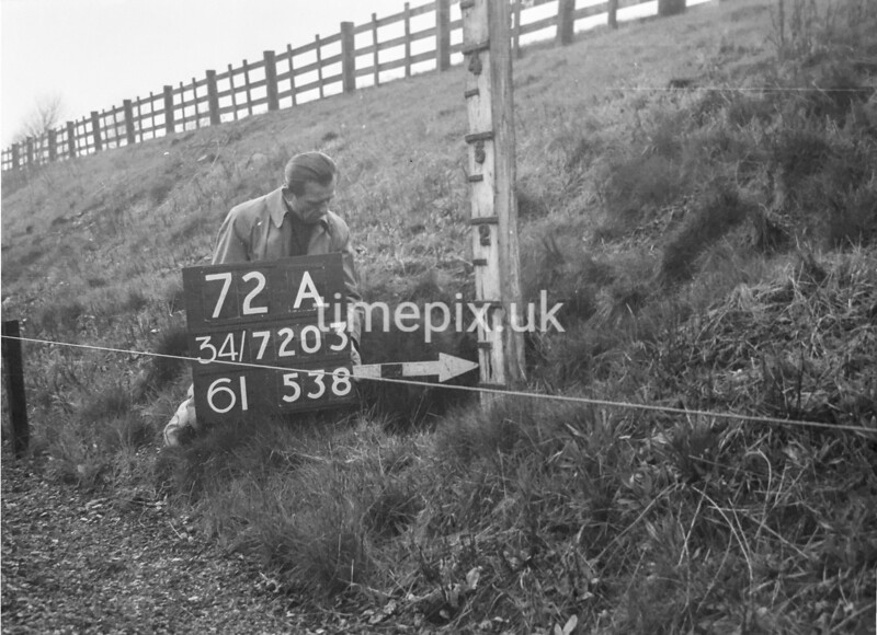 SD720372A, Man marking Ordnance Survey minor control revision point with an arrow in 1950s