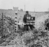 SD640898A, Man marking Ordnance Survey minor control revision point with an arrow in 1940s