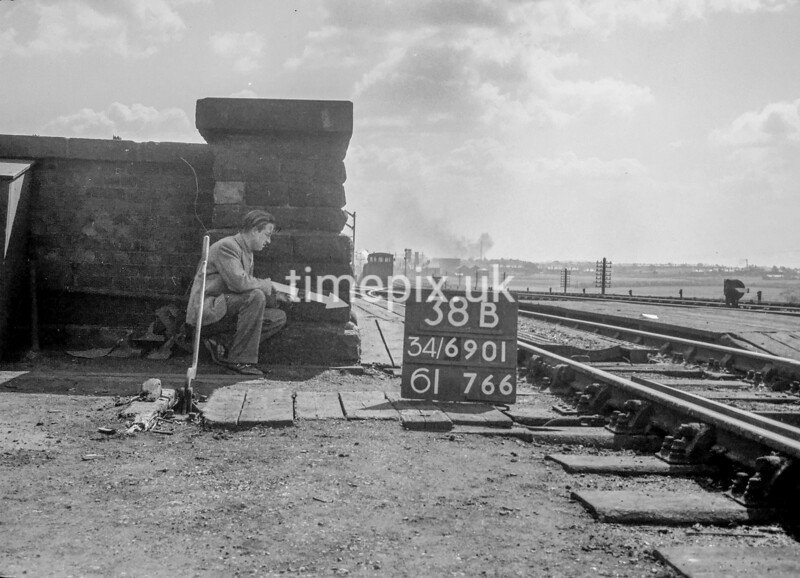 SD690138B, Man marking Ordnance Survey minor control revision point with an arrow in 1950s