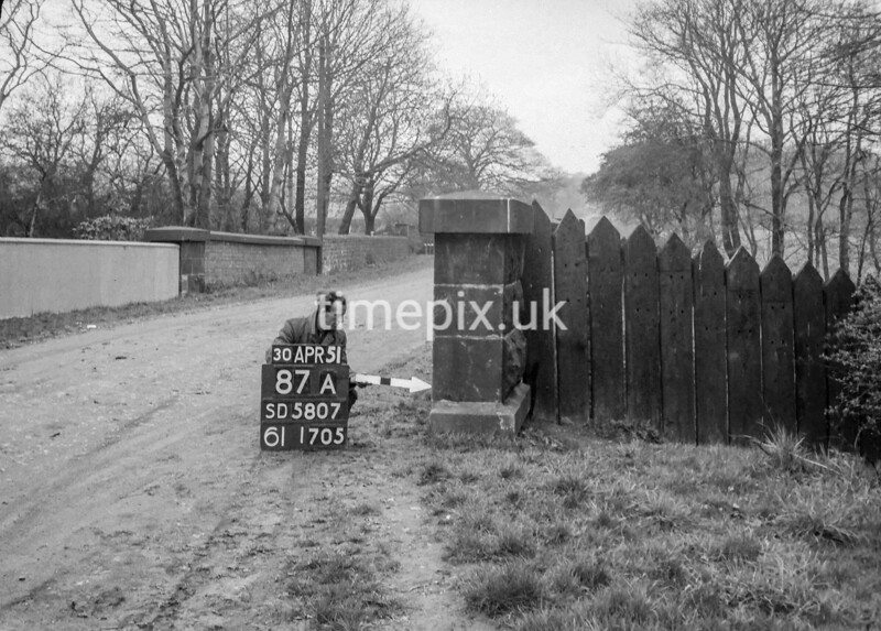 SD580787A, Man marking Ordnance Survey minor control revision point with an arrow in 1950s