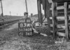 SD740883A, Man marking Ordnance Survey minor control revision point with an arrow in 1940s