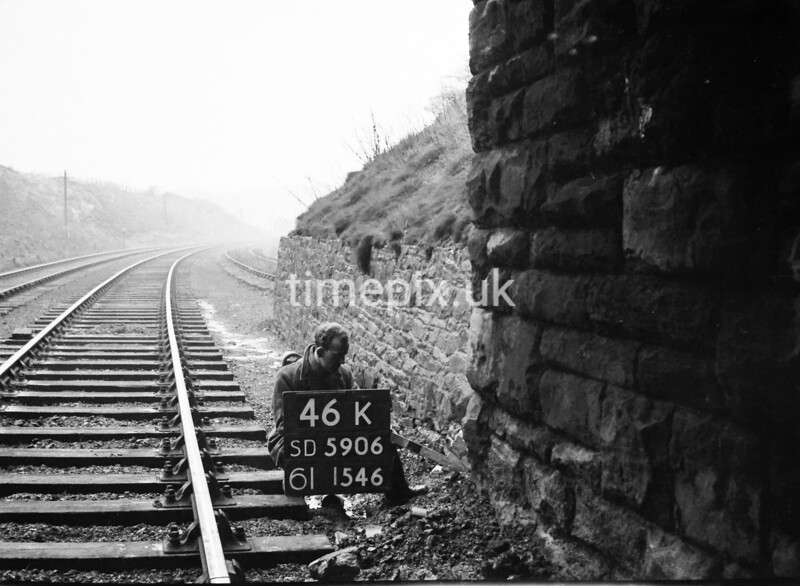SD590646K, Man marking Ordnance Survey minor control revision point with an arrow in 1950s