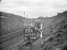 SD720420L, Man marking Ordnance Survey minor control revision point with an arrow in 1950s