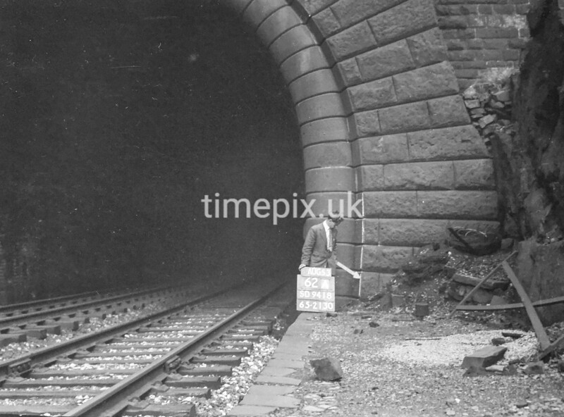 SD941862A, Man marking Ordnance Survey minor control revision point with an arrow in 1950s