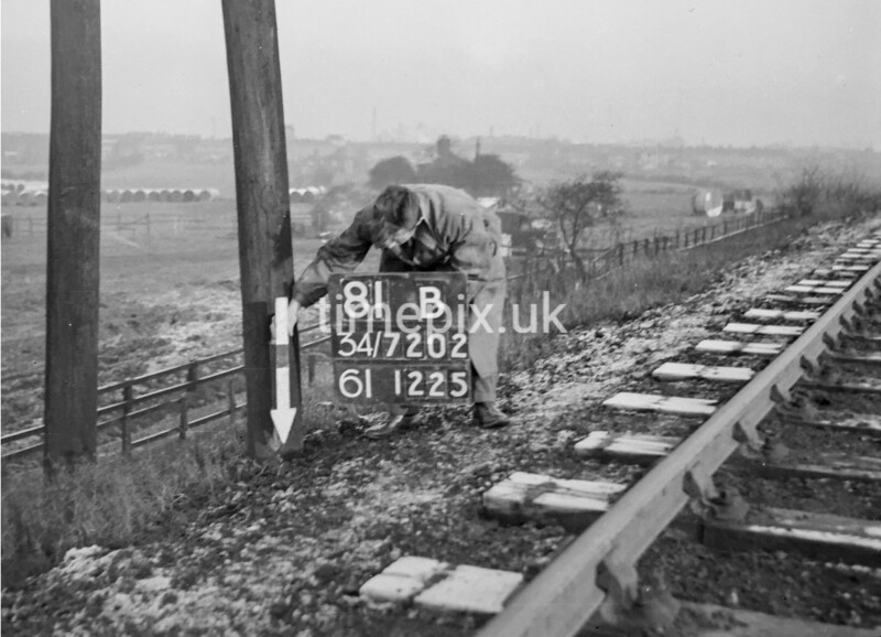 SD720281B, Man marking Ordnance Survey minor control revision point with an arrow in 1950s