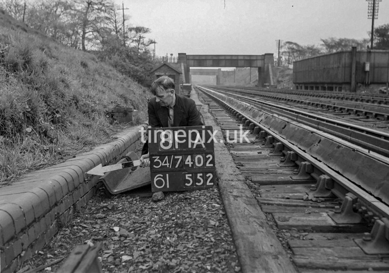 SD740281A, Man marking Ordnance Survey minor control revision point with an arrow in 1940s