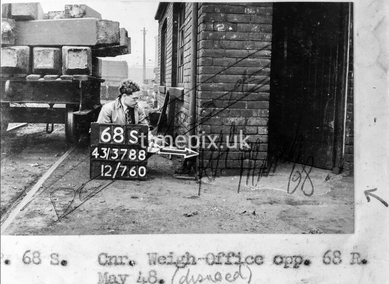 SK378868S, Man marking Ordnance Survey minor control revision point with an arrow in 1940s Sheffield
