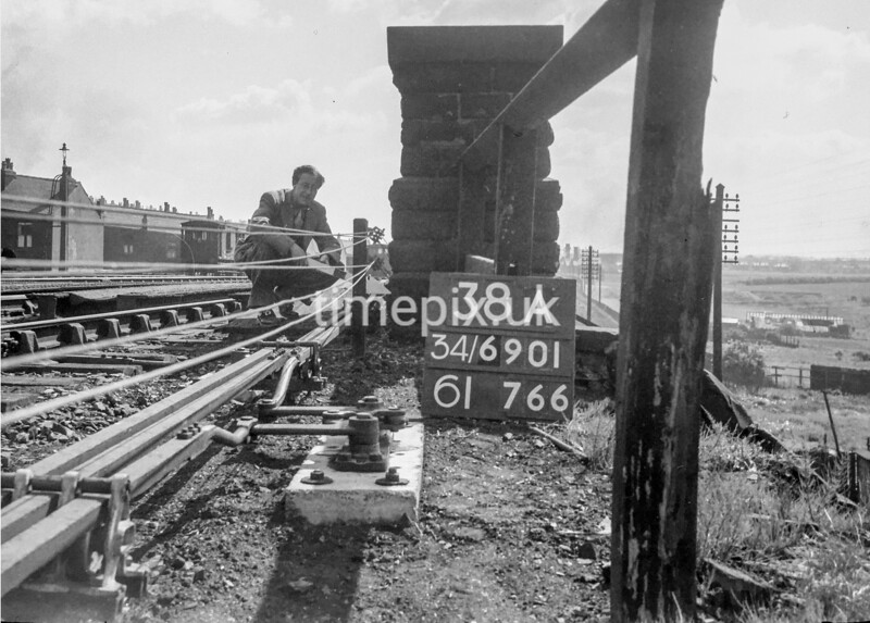 SD690138A, Man marking Ordnance Survey minor control revision point with an arrow in 1950s
