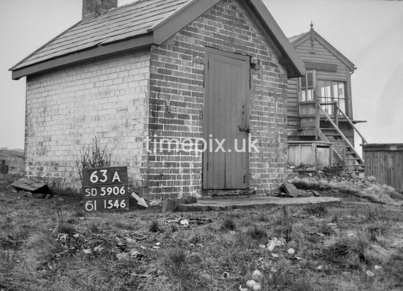 SD590663A, Man marking Ordnance Survey minor control revision point with an arrow in 1950s