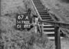 SD740167A, Man marking Ordnance Survey minor control revision point with an arrow in 1940s