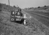 SD740147B, Man marking Ordnance Survey minor control revision point with an arrow in 1940s