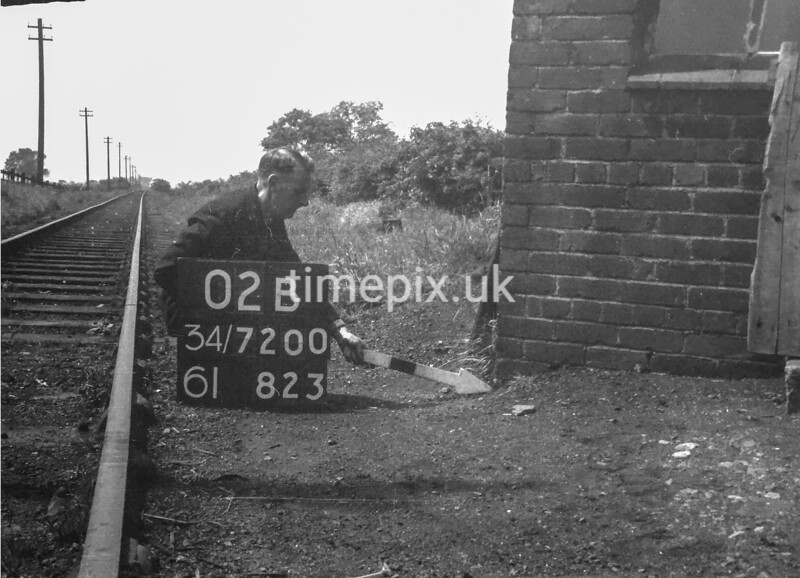 SD720002B, Man marking Ordnance Survey minor control revision point with an arrow in 1950s