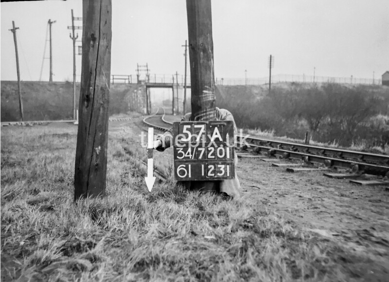 SD720157A, Man marking Ordnance Survey minor control revision point with an arrow in 1950s