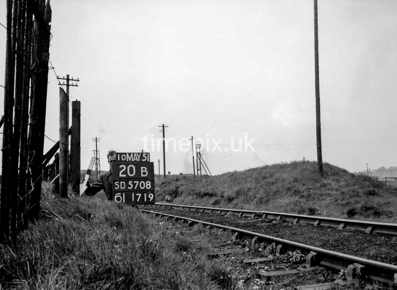 SD570820B, Man marking Ordnance Survey minor control revision point with an arrow in 1950s